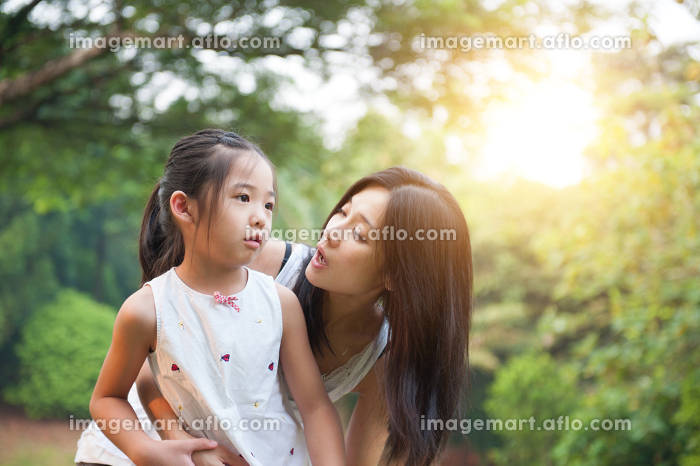 Mother and daughters at outdoors.の販売画像