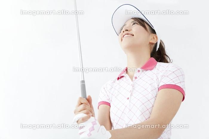 ゴルフクラブを握る女性の販売画像