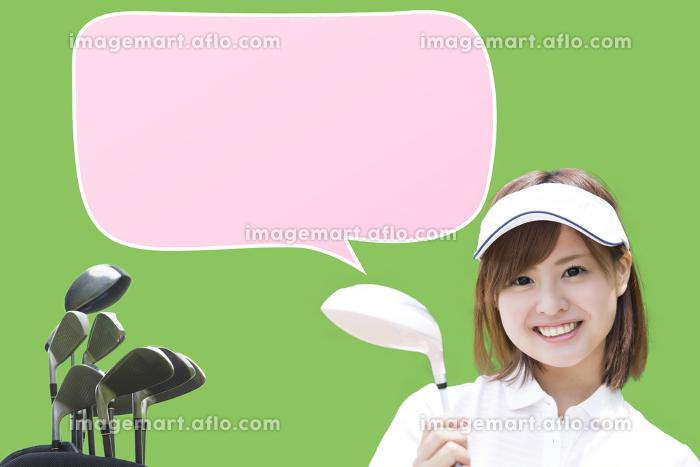 ゴルフクラブを持つ女性の販売画像