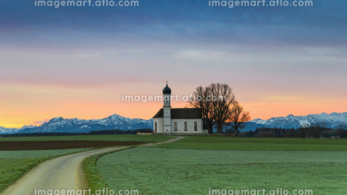 Morning Alpine landscape with sunrise over St. Andreas chapel