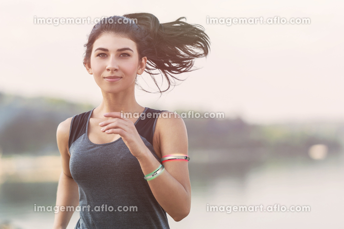 Young lady running on a beach during morning