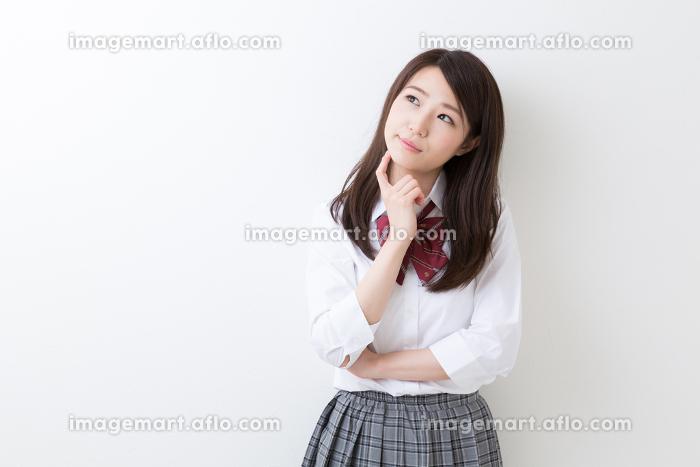 女子学生 考えるの販売画像