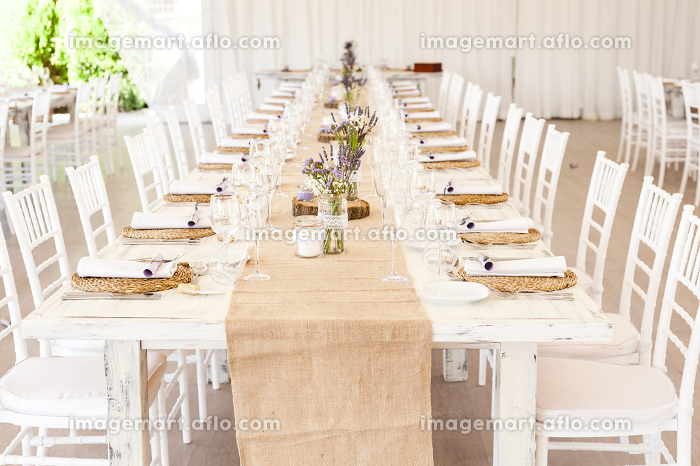 Decorated table with aromatic lavender plants ready for a weddingの販売画像