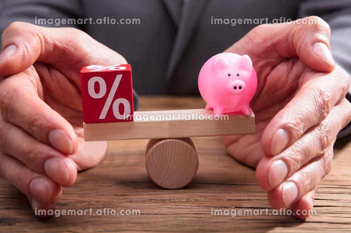 Human Hand Protecting Balance Between Percentage And Piggybankの販売画像