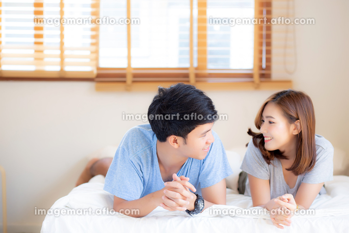 Beautiful portrait young asian couple relax and satisfied togethの販売画像