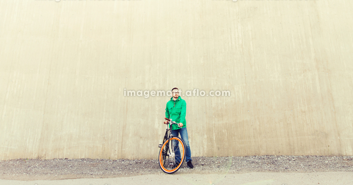 happy young hipster man with fixed gear bike