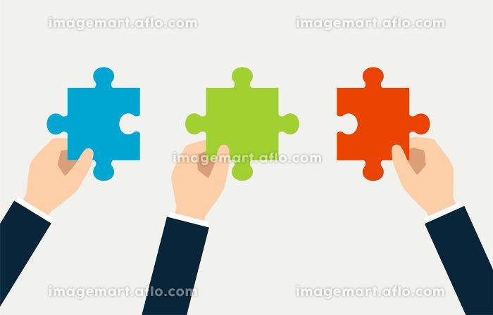 パズルとビジネスマンの手の販売画像