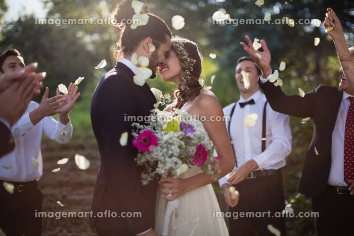 Affectionate bride and groom kissing on their wedding dayの販売画像
