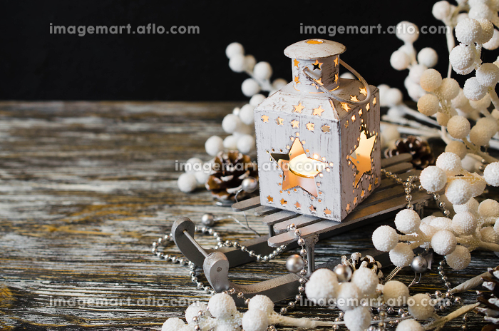 Christmas still life with lantern and decorations