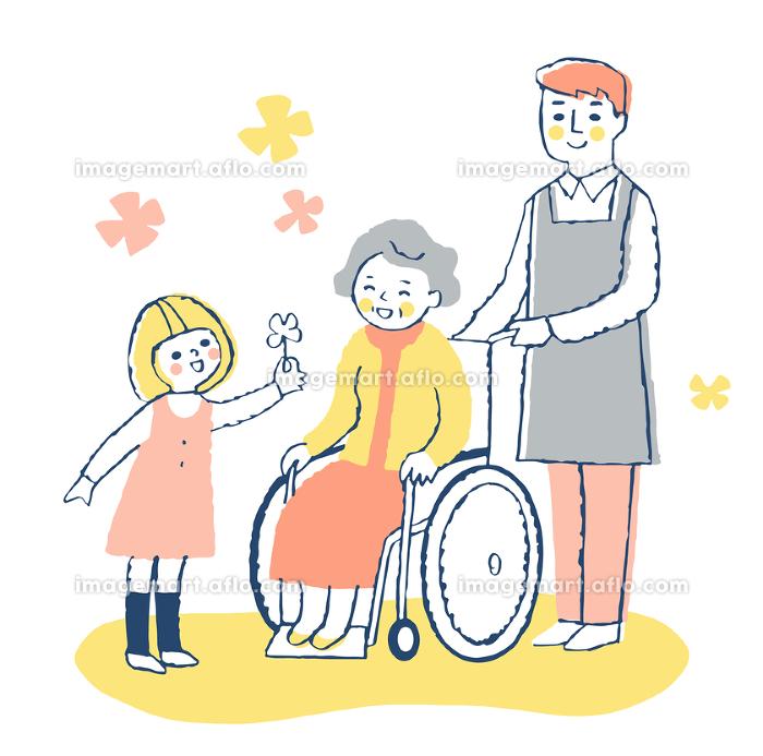 女の子と車椅子のシニア女性と男性介護スタッフの販売画像