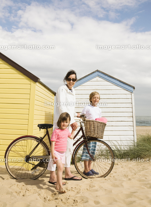 Woman and children with bike
