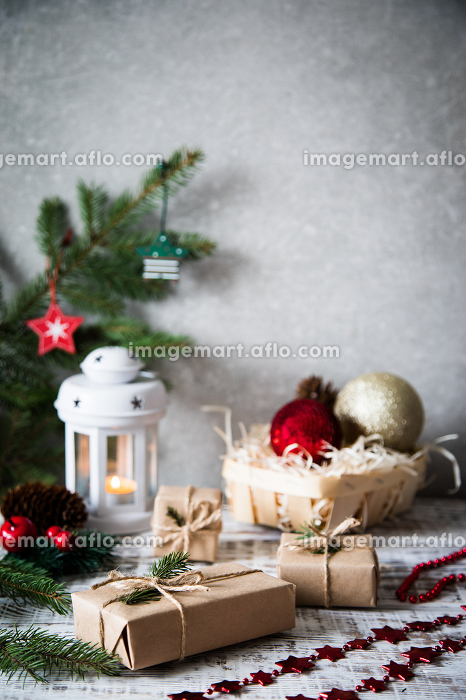 Christmas background. Christmas composition. Christmas gift, pine cones, fir branches on wooden white background.