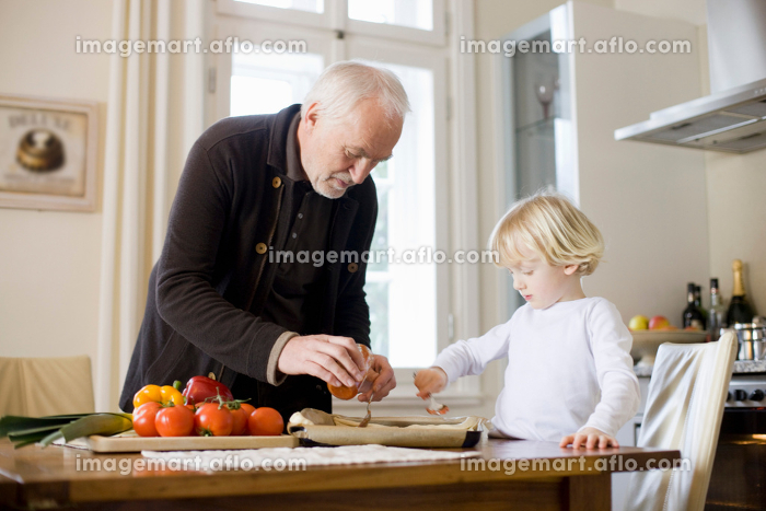 grandfather and grandson cooking