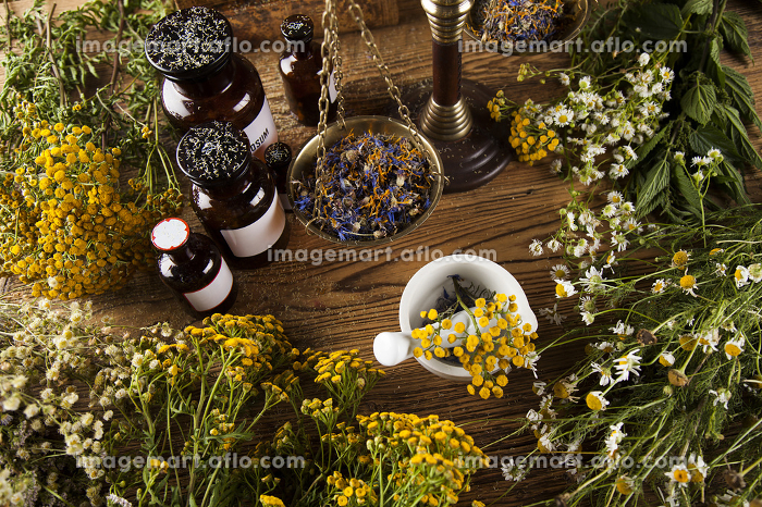 Herbal medicine and book on wooden table backgroundの販売画像