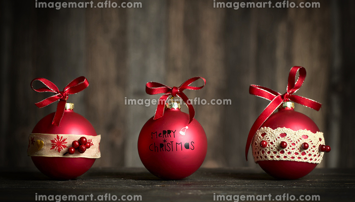 red christmas balls on wooden background - self made bauble