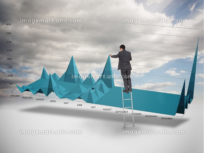 Businessman on a ladder catching the tip of a chart with cloudy sky on the backgroundの販売画像