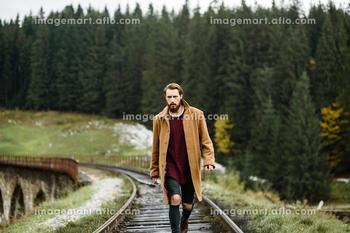 brutal bearded man walks on the tracksの販売画像