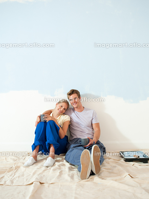 Young couple taking a break from decorating