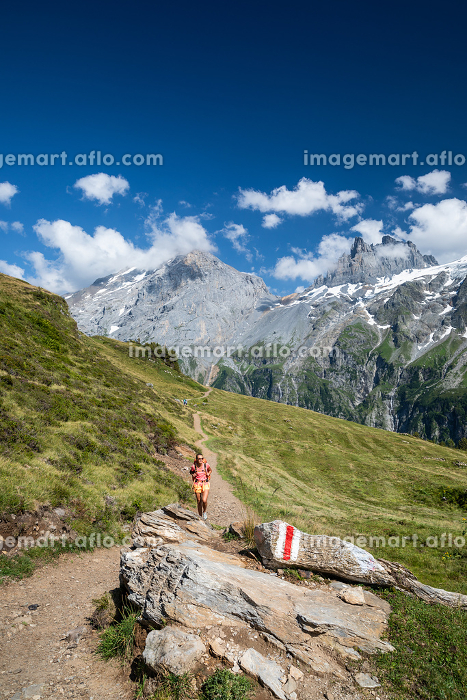 Pretty, female hiker/climber in a lovely alpine setting of Swiss Alpsの販売画像