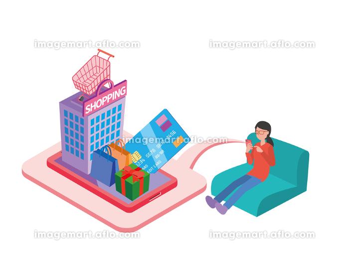 ソファに座ってネットショッピングする女性の販売画像