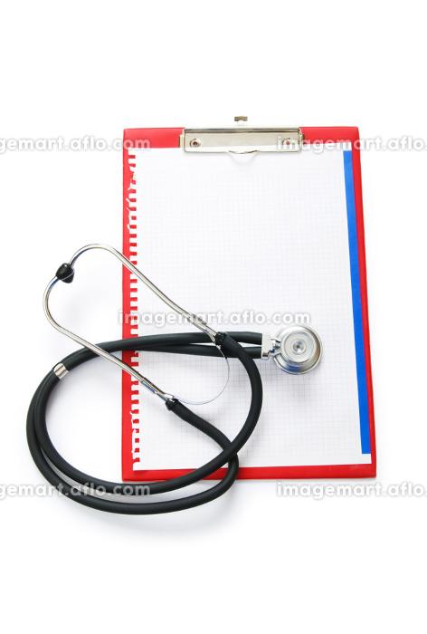 Stethoscope on the binder isolated on whiteの販売画像