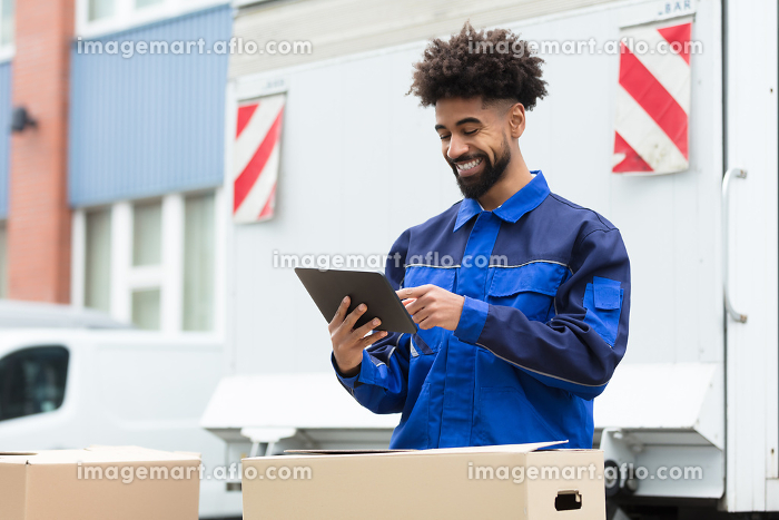 Delivery Man Checking His Order On Digital Tabletの販売画像