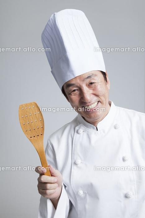 微笑む調理師の販売画像