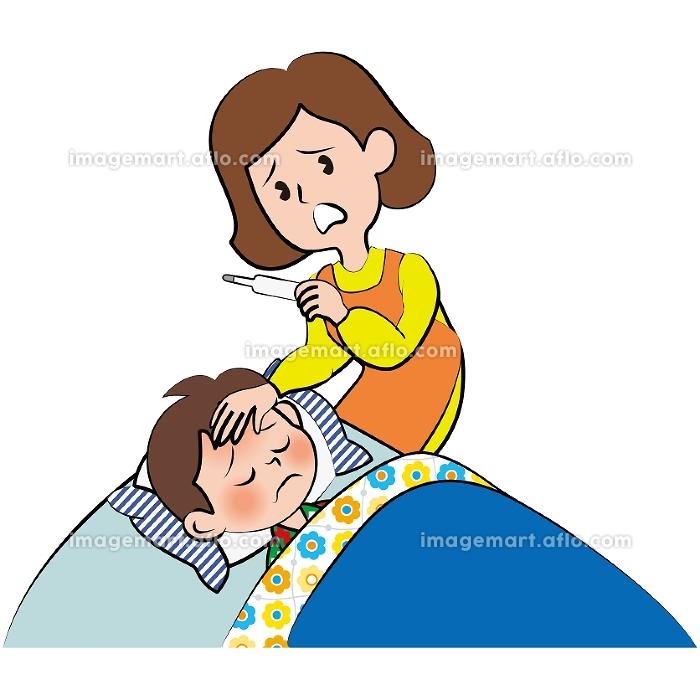 息子の熱を測る母親