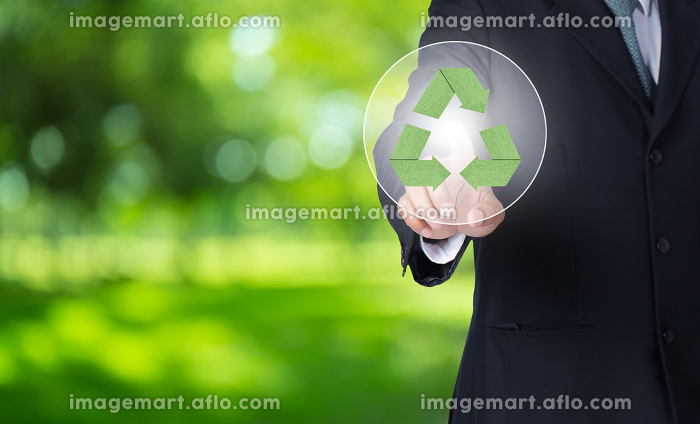 business man finger pointing at paper green recycle symbol with