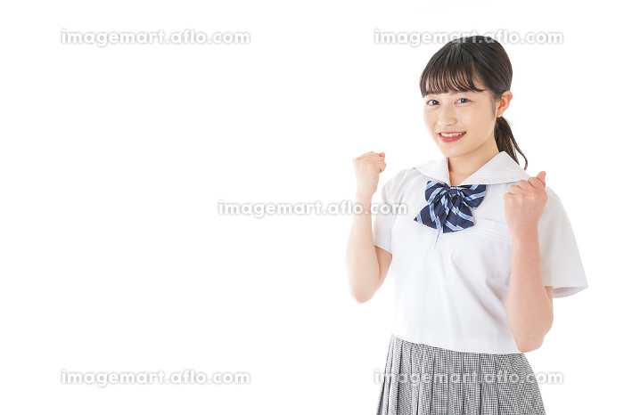 ガッツポーズをする笑顔の女子学生の販売画像