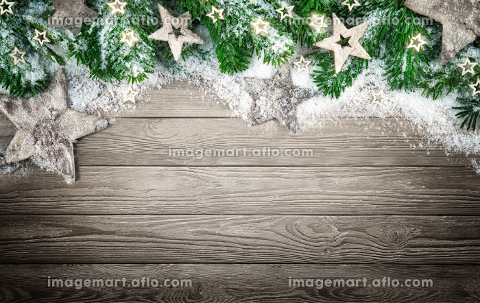background for christmas and advent,with wood,snow and pine branchesの販売画像