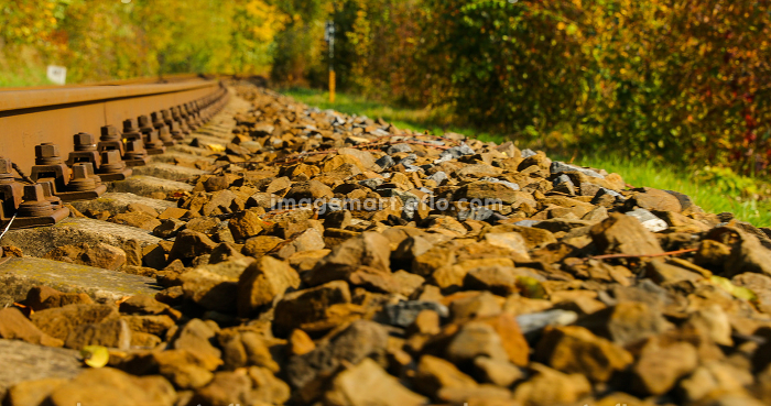 A close-up view of the large screws securing the train tracks , Czechia, Zlin Region, Valasske Meziriciの販売画像