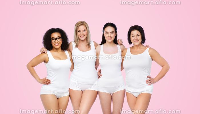 group of happy different women in white underwearの販売画像