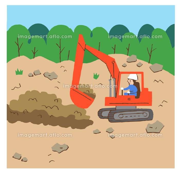 ショベルカーで土を掘る作業員