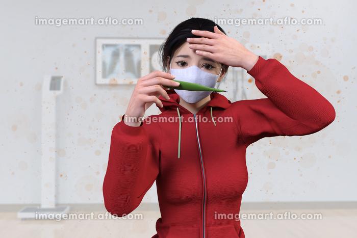 ウイルス性の病気に感染した日本人女性が体温計で熱を測っている周りをウイルスが空気中を舞うの販売画像