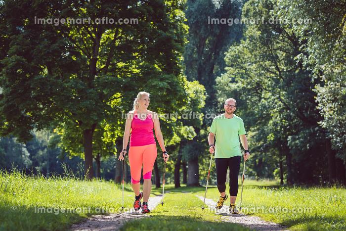 Couple doing Nordic Walking for sportの販売画像