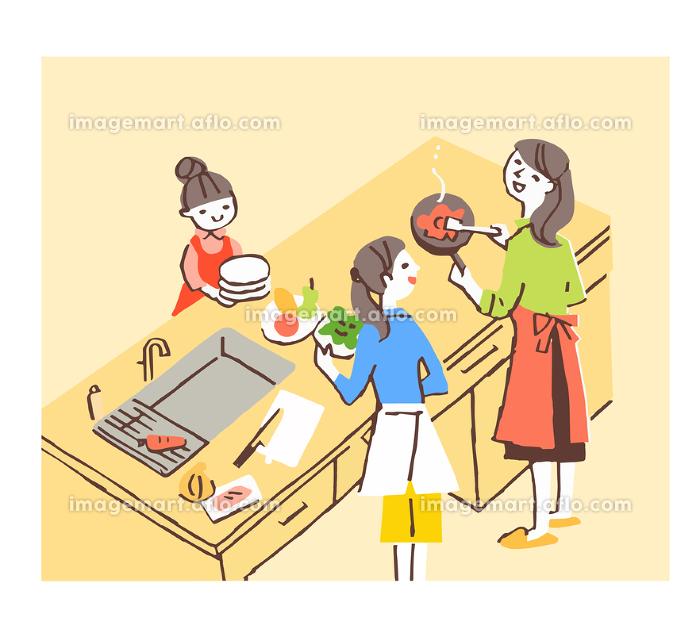 アイランドキッチンで調理をする女性の販売画像