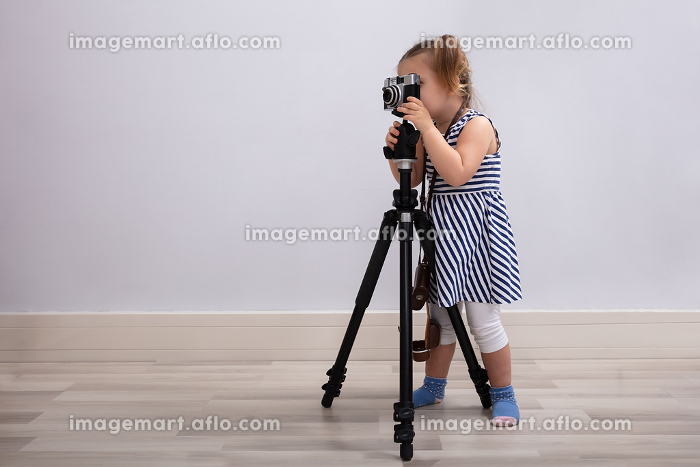 Girl Taking Photo With Camera And Tripod