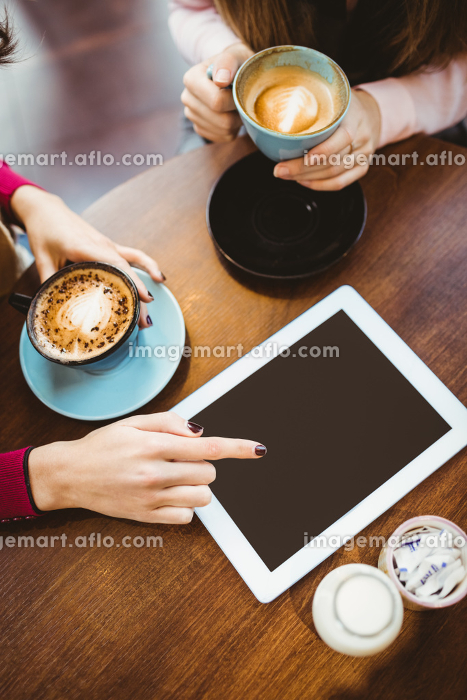 Friends using tablet togetherの販売画像
