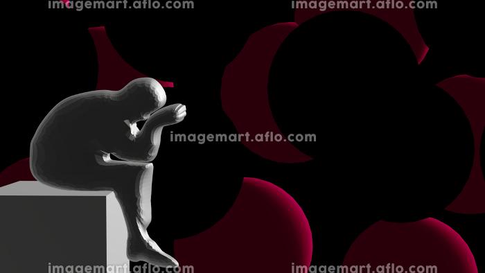 座りながら落ち込む人の影の販売画像
