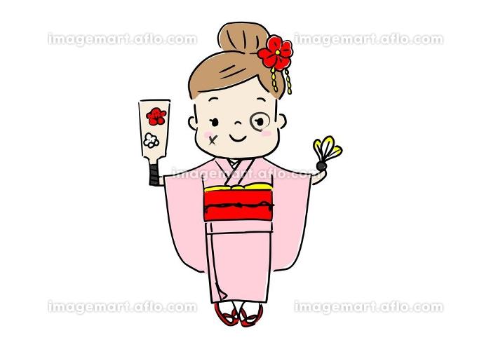お正月 着物を着て羽子板を遊び 顔に墨を塗の販売画像