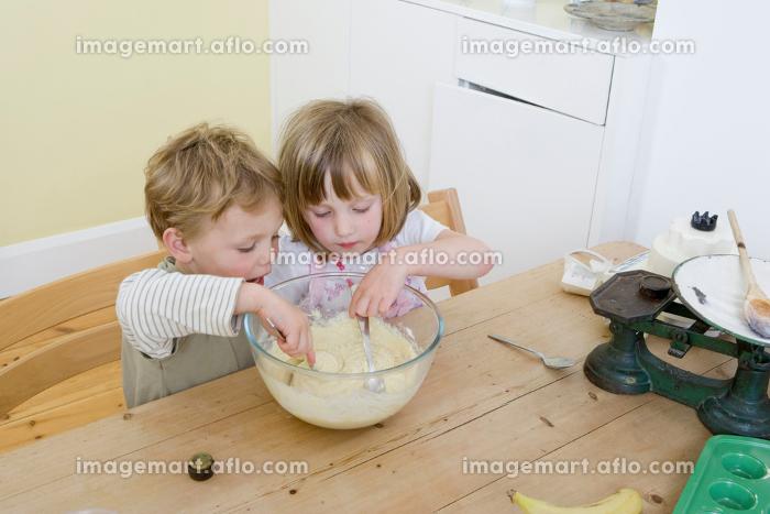 boy and girl mixing cake