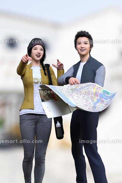 地図を広げたスタジャンを着た男の子とイエローのジャケットを着た女の子が目的地を探しながら歩いているの販売画像