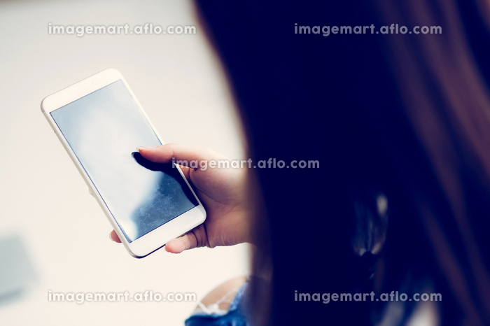 Woman hand holding smart mobile phone with message or email, gir