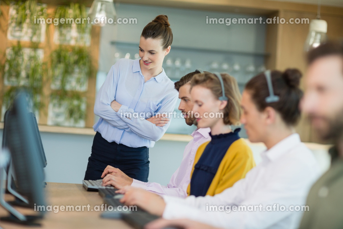 Customer service executives working in call centerの販売画像