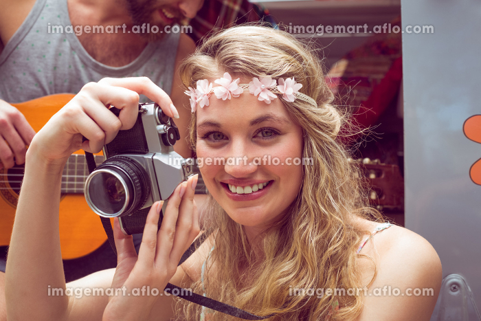 Pretty hipster taking a photo