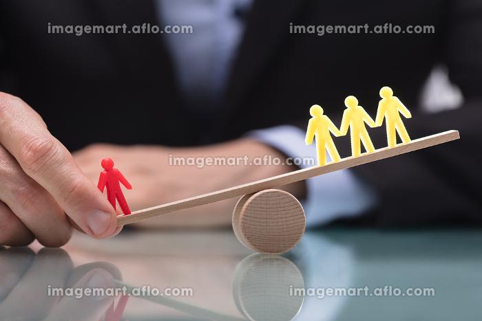 Businessperson Showing Imbalance Between Figures On Seesawの販売画像