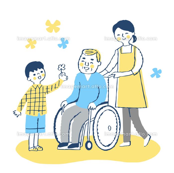 男の子と車椅子のおじいちゃんと女性介護スタッフの販売画像