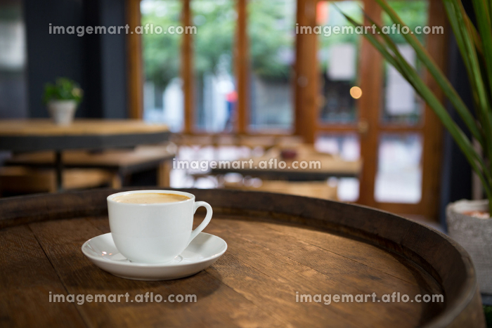 Cup of coffee on table at cafeteriaの販売画像