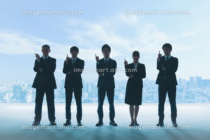 人差し指を立てるビジネスパーソンのシルエット